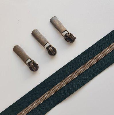 Dark green with bronze zipper teeth