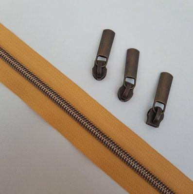 Mustard yellow with bronze zipper teeth