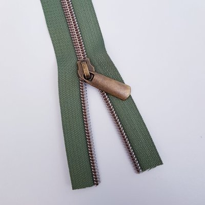 Khaki green with bronze zipper teeth