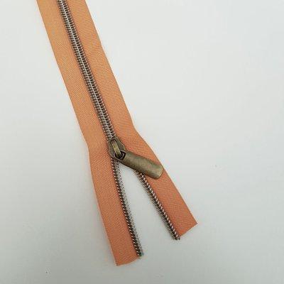 Orange with bronze zipper teeth