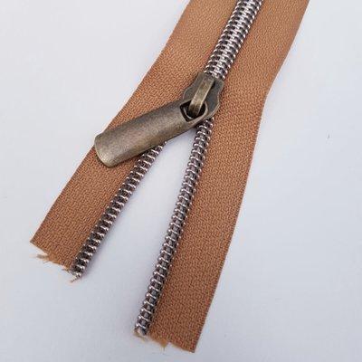 Bronzy brown with bronze zipper teeth