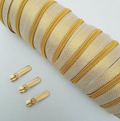 Gold with golden zipper teeth