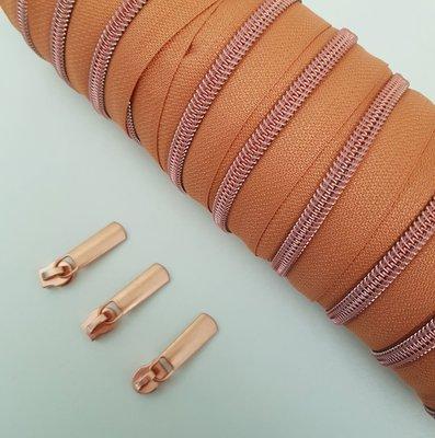 Bronze with rosé zipper teeth