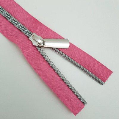Roze met nikkel/zilveren tandjes