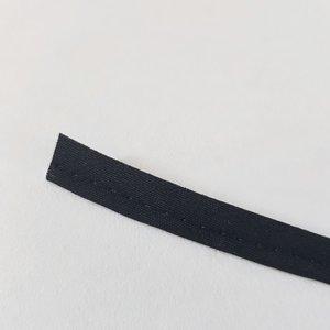 Paspel zwart