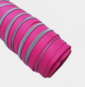 Rits fluo roze met nikkel/zilveren tandjes