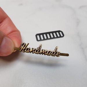 'Handmade' label brons